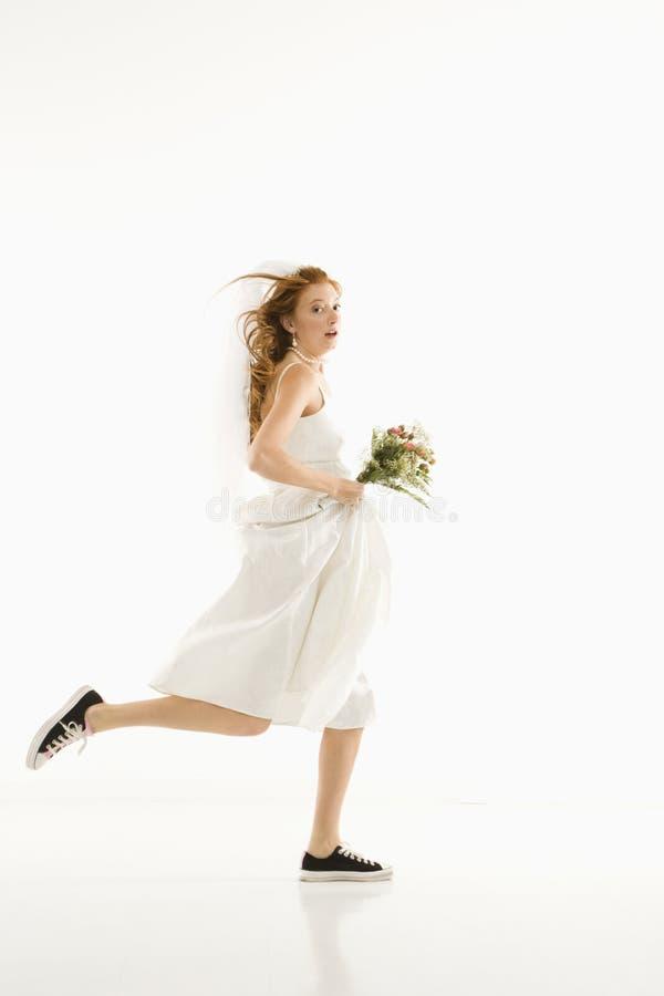 新娘运行中 库存照片