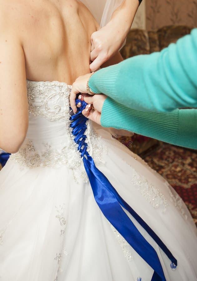 新娘系带束腰礼服 免版税库存照片