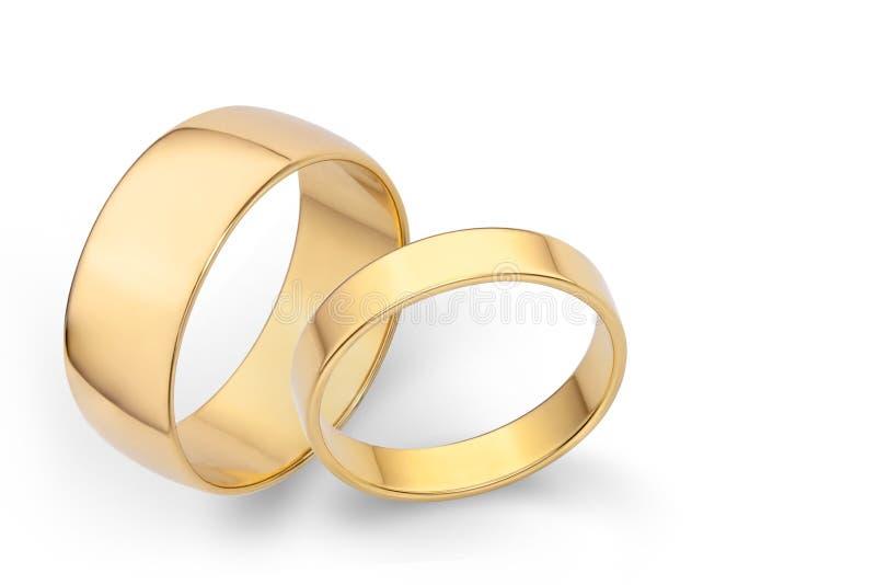 新婚佳偶的两只美好的金戒指 库存图片