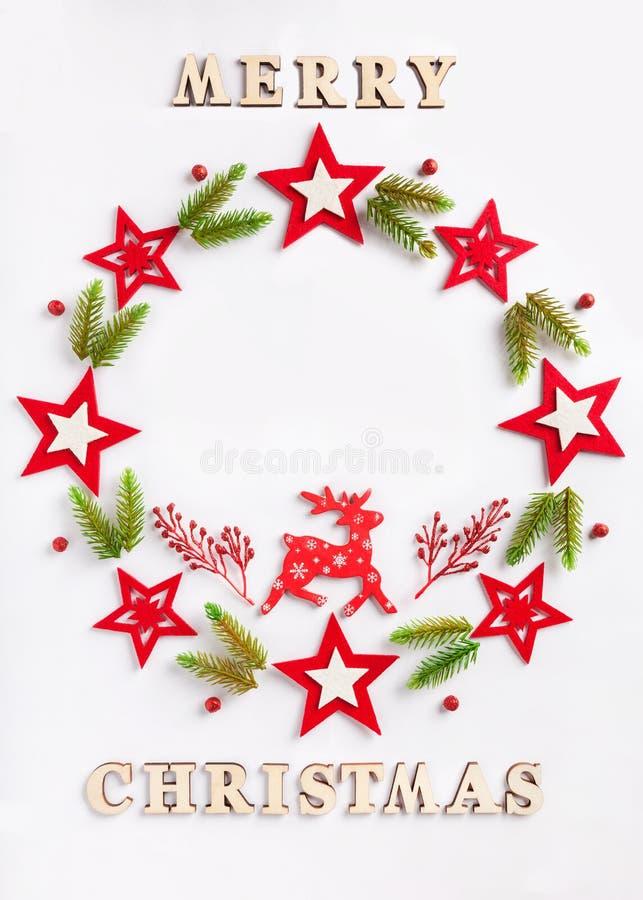 新年在白皮书的贺卡与题字圣诞快乐 免版税库存照片