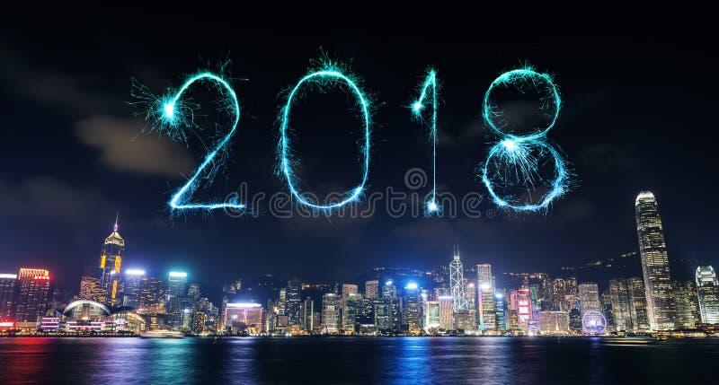 2018新年好与香港都市风景的烟花闪闪发光 库存图片