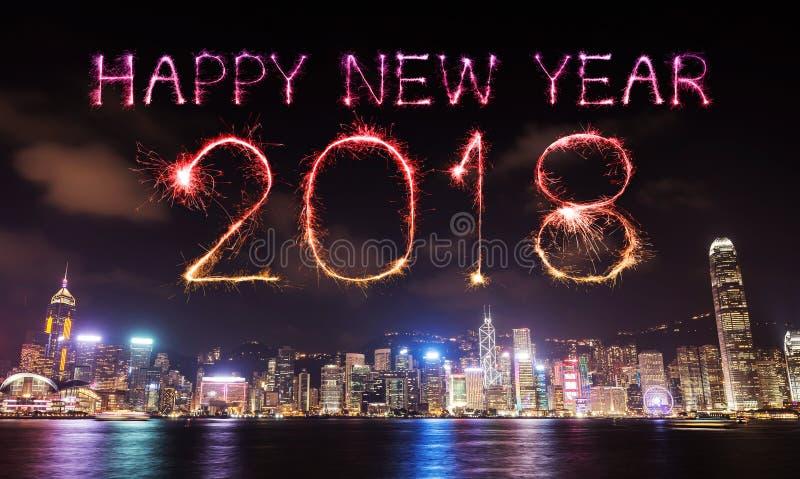 2018新年好与香港都市风景的烟花闪闪发光 免版税库存图片