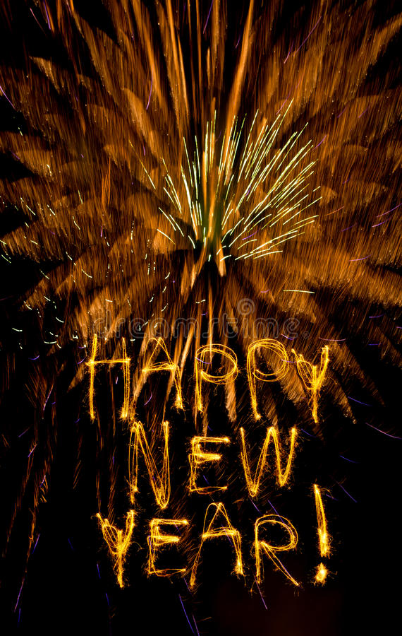 新年度闪烁发光物和烟花 免版税库存照片
