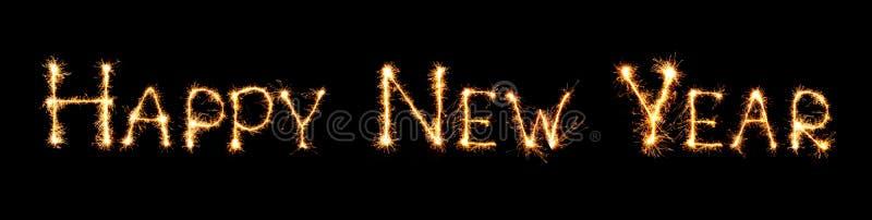 新年快乐文本手工制造书面闪闪发光烟花 在黑背景隔绝的美好的发光的金黄信件印刷术 免版税库存图片
