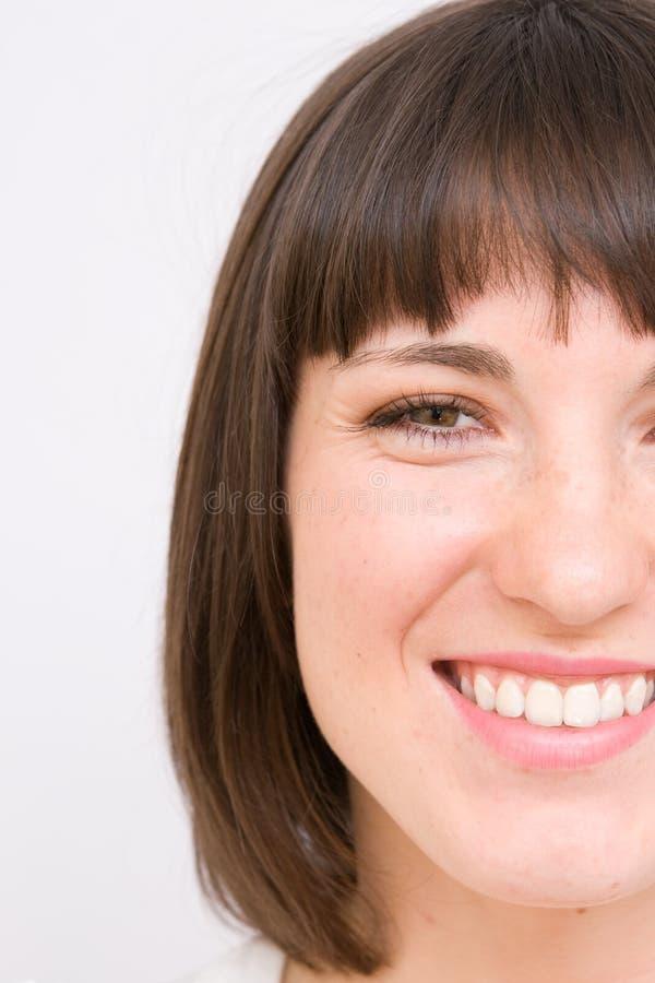 新微笑的妇女 免版税库存图片