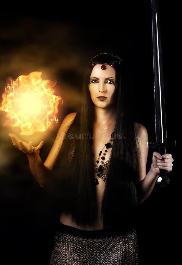 新性感的妇女巫婆战士 免版税库存图片