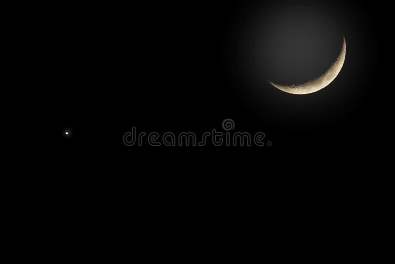 新月形月亮和金星背景 库存图片