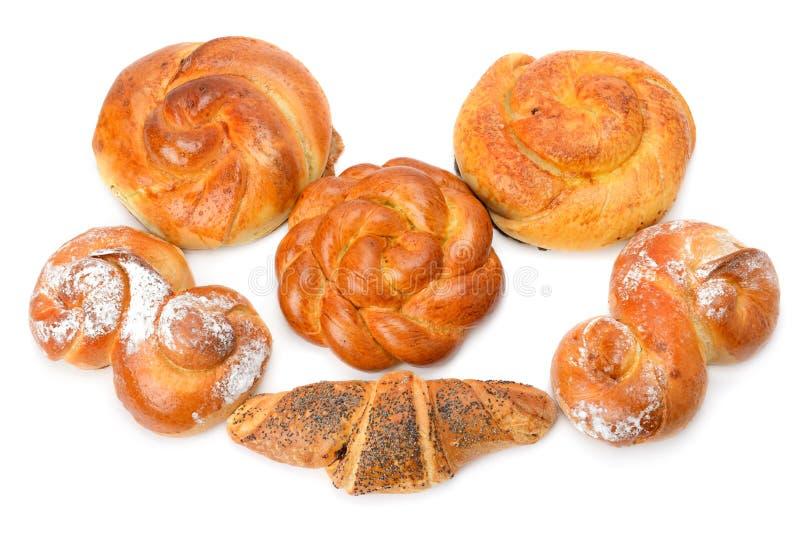 新月形面包和小甜面包在白色背景 免版税图库摄影