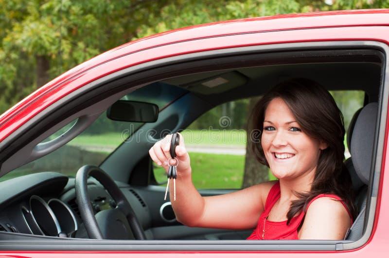 新汽车的女孩 免版税库存图片
