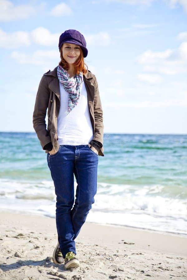 新海滩日方式晴朗的妇女 库存图片