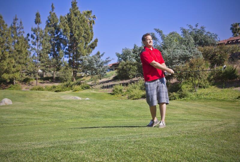 新男性使用的高尔夫球 免版税库存照片