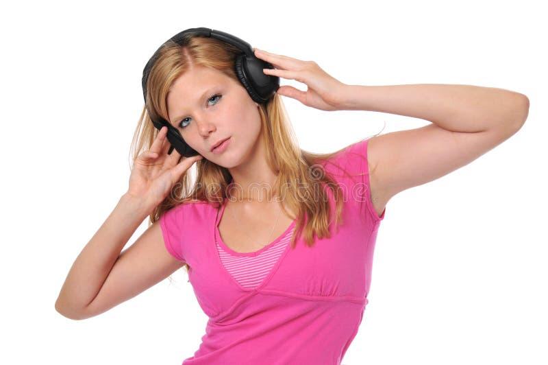 新白肤金发的耳机 库存图片