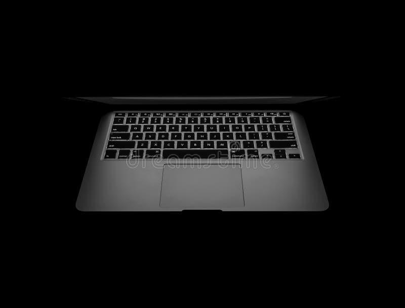 新的Macbook赞成在黑暗 库存图片