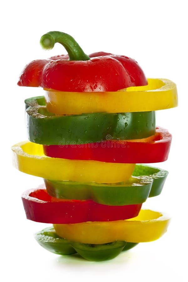 新绿色查出的辣椒粉红色空白黄色 免版税库存图片