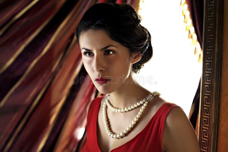 新美丽的妇女特写镜头红色礼服的 图库摄影