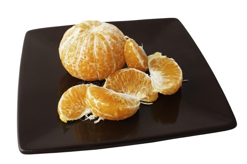 新蜜桔切片板材在白色背景的 免版税库存照片