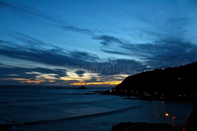 新西兰夕阳时的惠灵顿海滩 库存图片