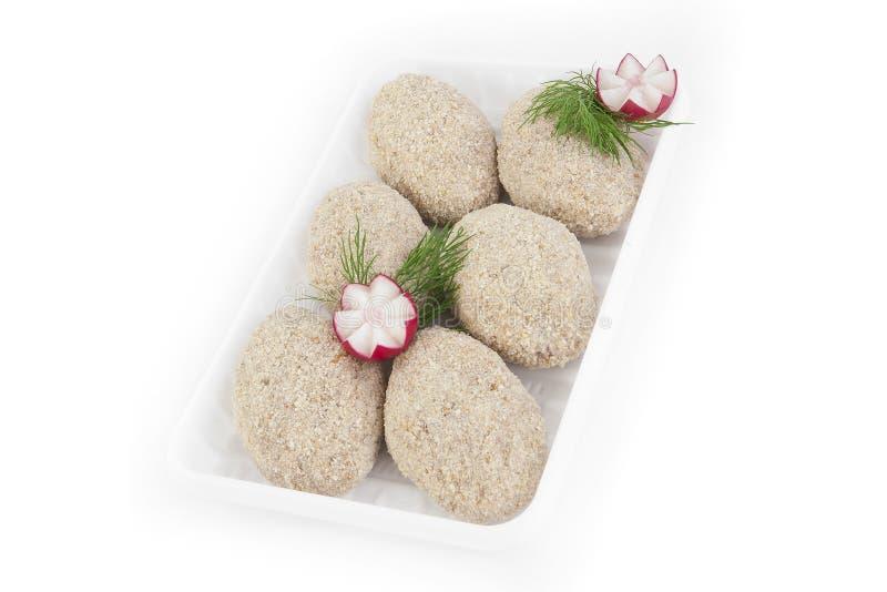 新近地结冰的半成品 从鸡嫩肉的炸肉排在盖子的由饼干制成 产品在pl被包装 库存照片
