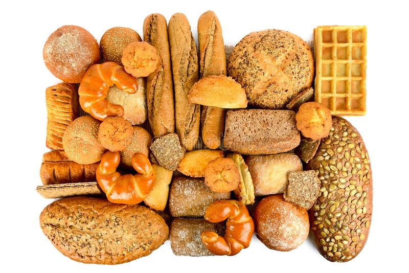 新近地被烘烤的在白色隔绝的面包和小圆面包 库存照片
