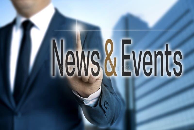 新闻和事件触摸屏幕由商人管理 库存照片