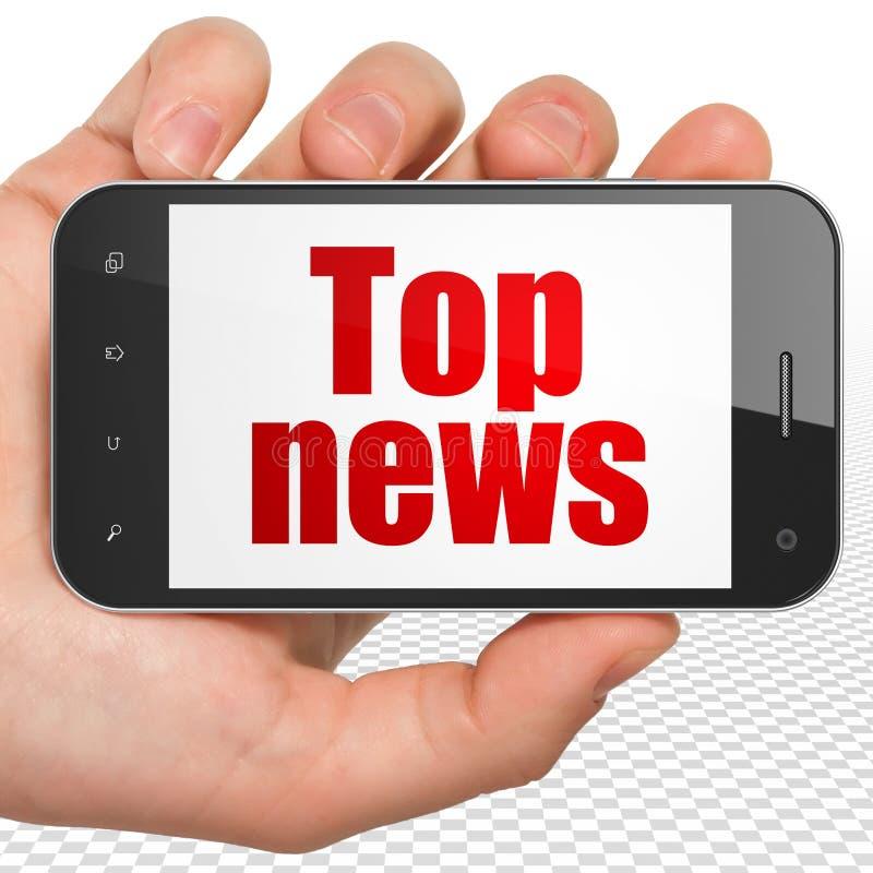 新闻概念:递拿着有最新新闻的智能手机在显示 库存照片