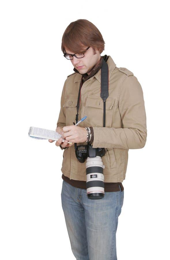 新闻记者男记事本 免版税图库摄影