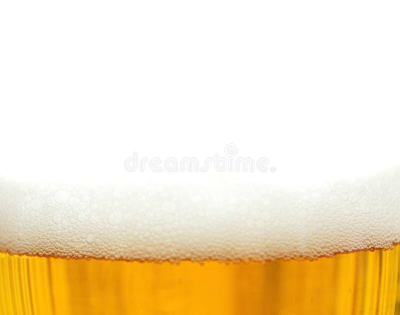 新鲜啤酒的泡沫 免版税库存照片