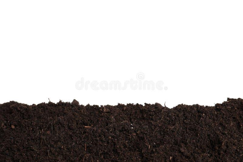 新鲜的土壤层数在白色的 从事园艺的时间 免版税库存图片