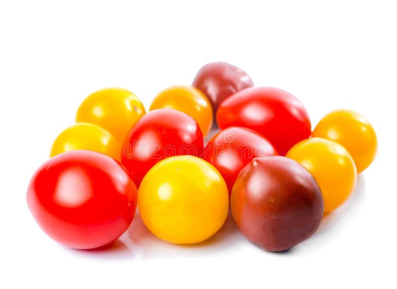 新鲜的成熟红色,黄色和黑樱桃蕃茄 免版税图库摄影