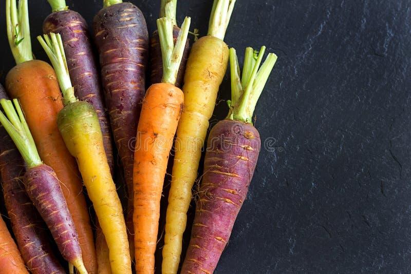 新鲜的有机彩虹红萝卜 库存图片