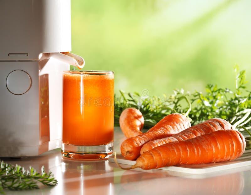 新鲜的红萝卜汁 图库摄影