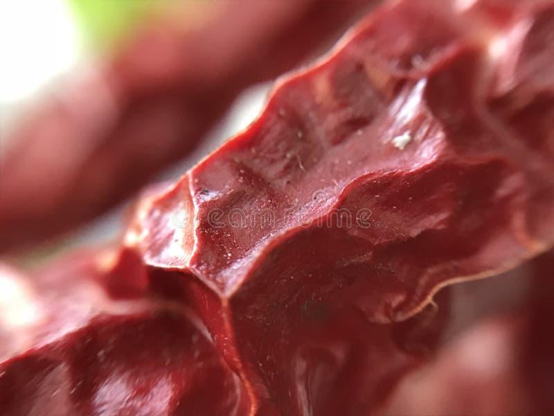 新鲜红色非常热的冷颤的胡椒的特写镜头 库存照片