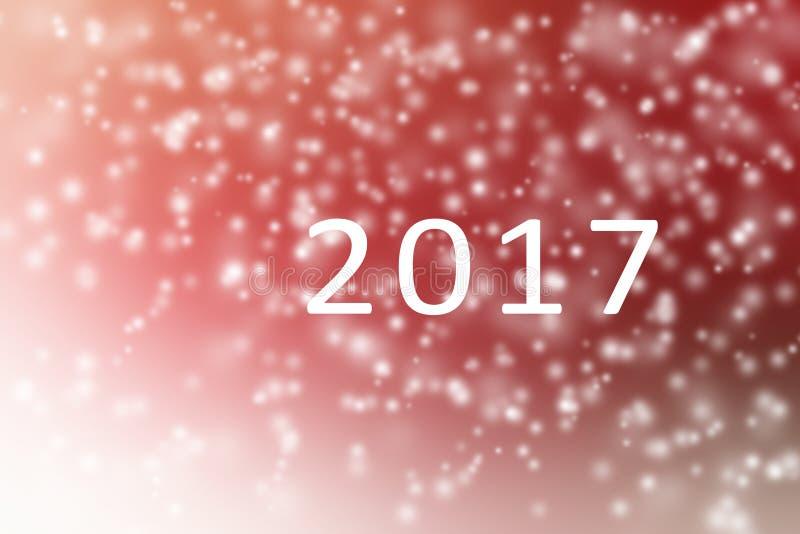 新年好2017抽象红色和白色与落为背景的雪 免版税库存照片