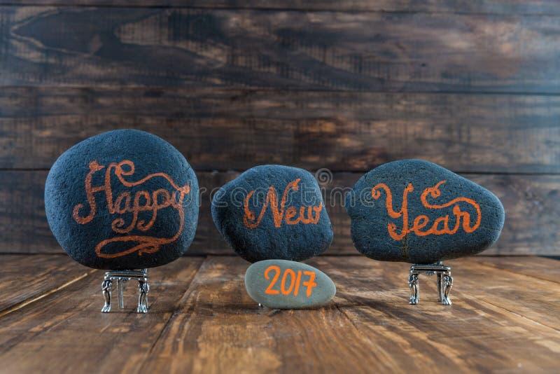 新年快乐2017书面的手字法 免版税库存照片