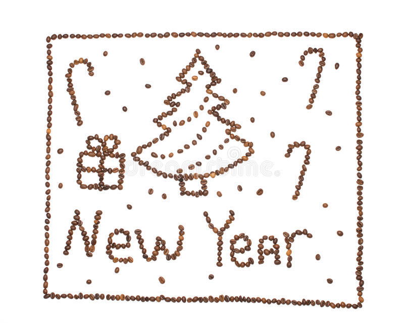 新年概念由被隔绝的咖啡豆制成在白色 免版税库存照片