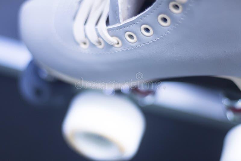 方形字体四轮溜冰鞋 图库摄影