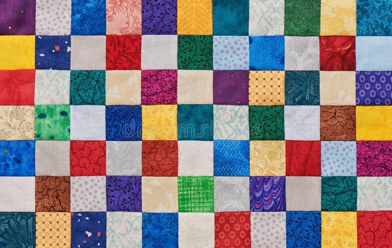 从方形的片断缝合的被子五颜六色的细节 库存图片