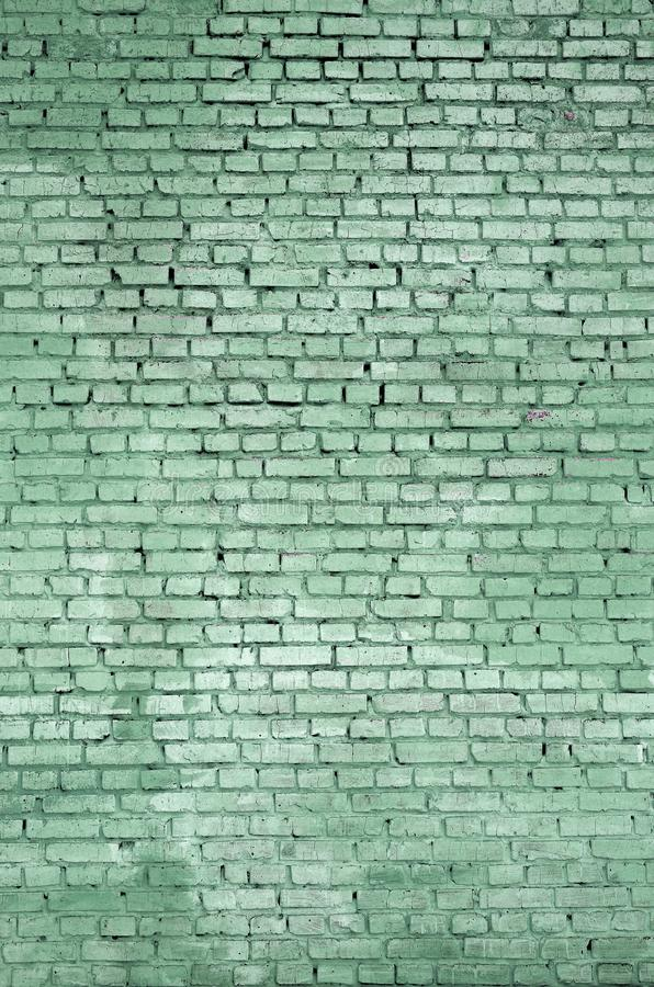 方形的砖块墙壁背景和纹理 绘以绿色 免版税库存照片