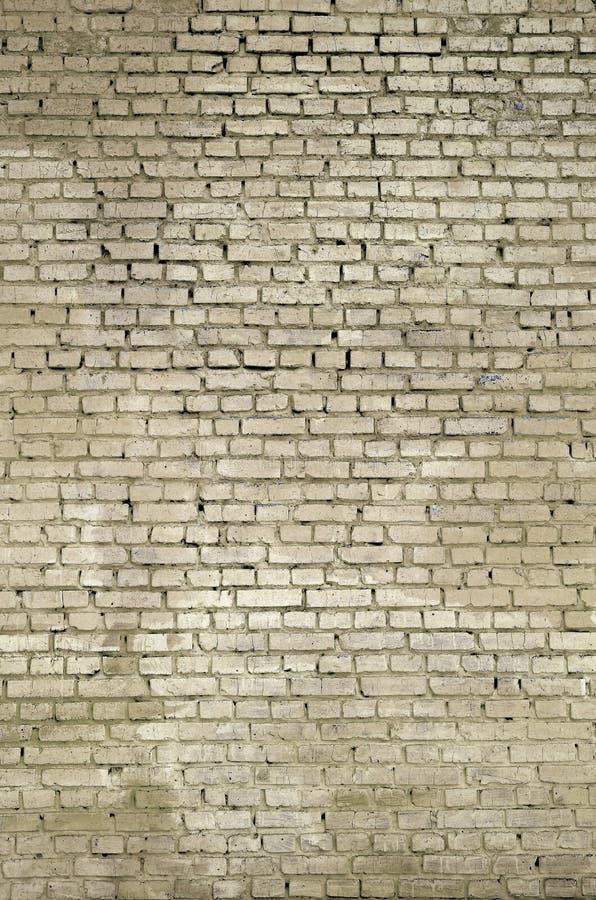 方形的砖块墙壁背景和纹理 绘在yello 库存图片