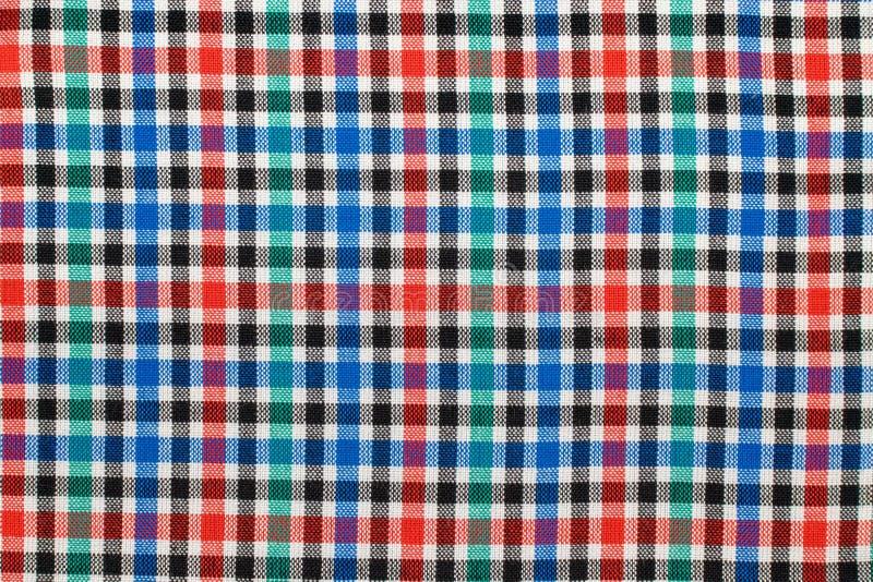 方格的格子花呢披肩织品背景 红色蓝绿色格子花呢披肩织品布料纹理  免版税库存图片