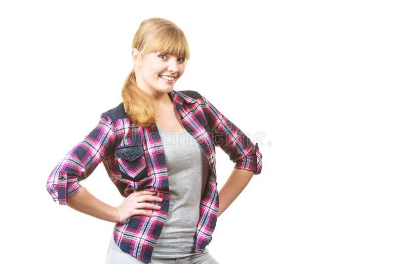 方格的衬衣的愉快的快乐的看的妇女 免版税库存图片