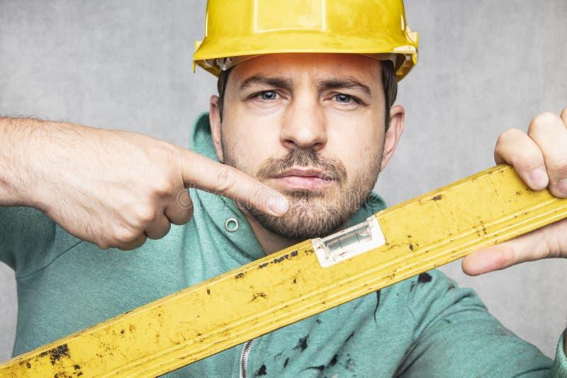 施工者掌握施工中的精神层次和精确性 免版税库存照片