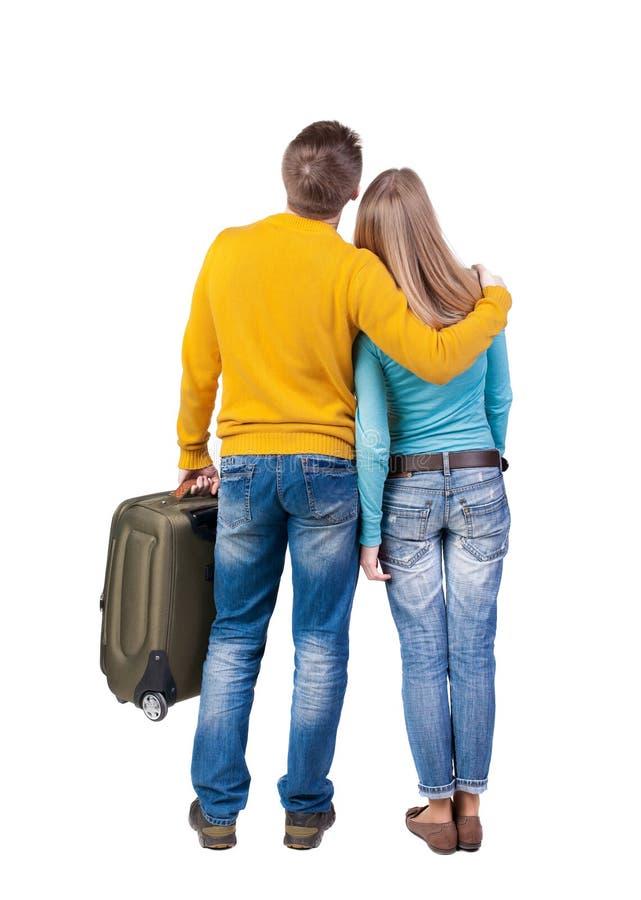 旅行与suitcas的年轻夫妇 图库摄影