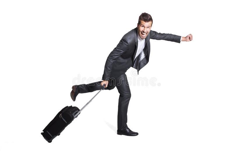 旅行为工作的愉快的商人 免版税库存照片