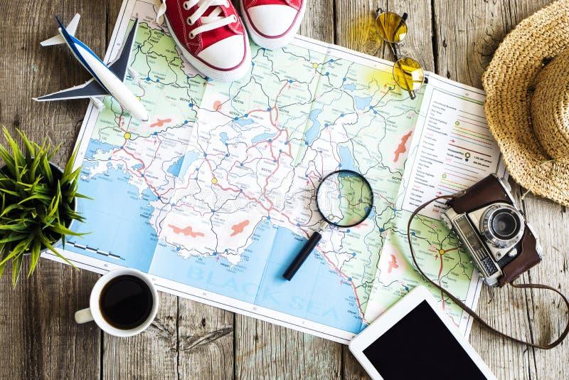 旅行在地图的计划概念 免版税库存照片