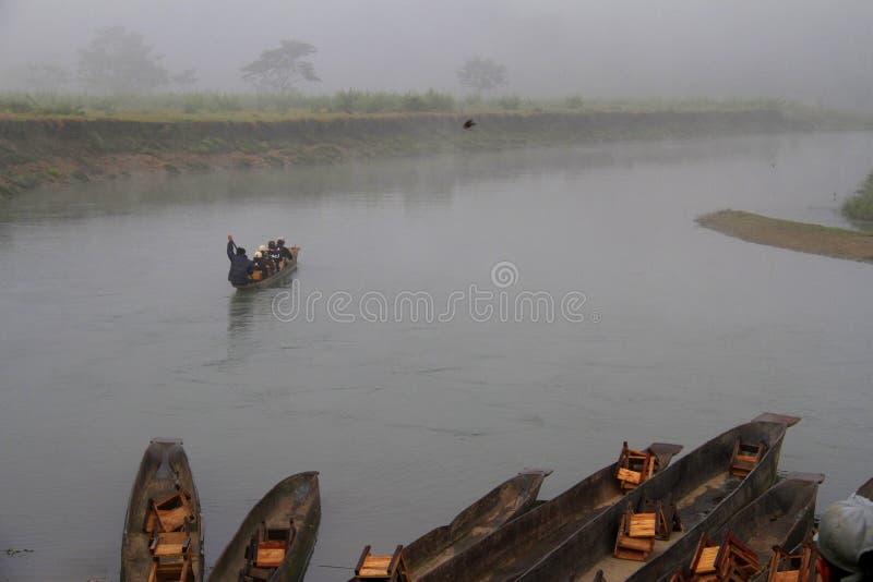 旅行尼泊尔: 独木舟骑马在Chitwan国家公园 库存照片