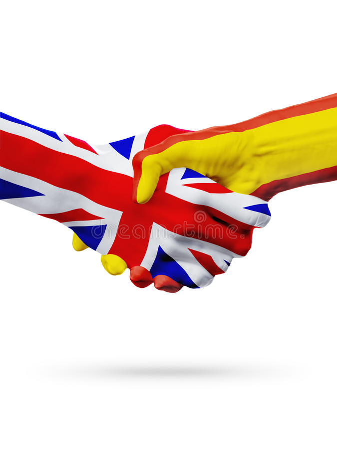旗子英国,西班牙国家,合作友谊握手概念 免版税库存照片