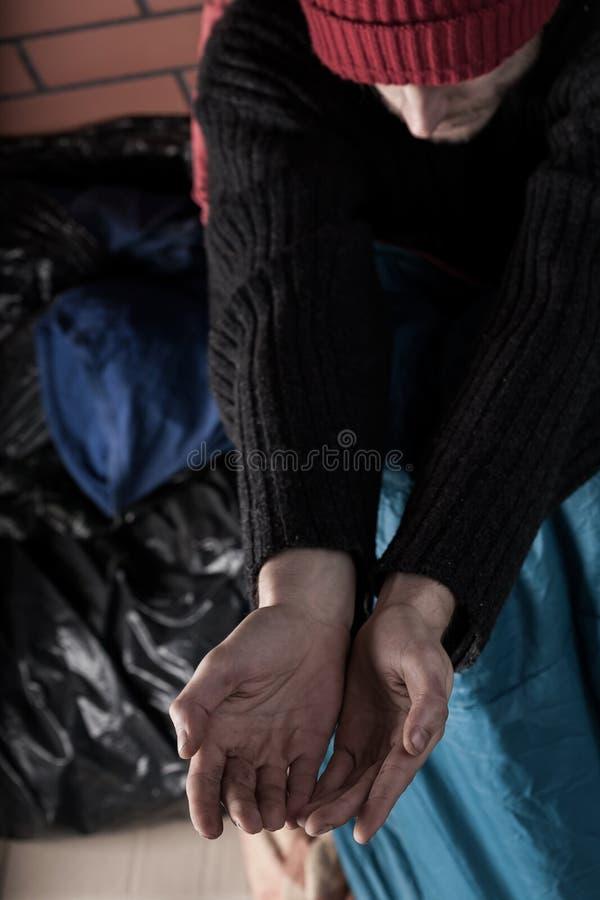 无家可归乞求帮助的 免版税库存图片