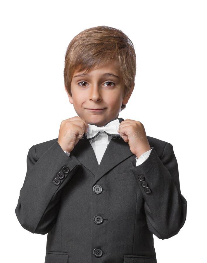无尾礼服的小男孩 免版税库存图片