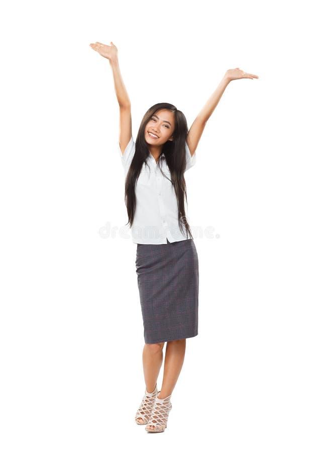 无忧无虑的有可爱的微笑和手的企业亚裔妇女 免版税库存图片
